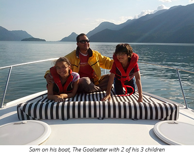 Sam with 2 of his 3 children on his boat, The Goalsetter